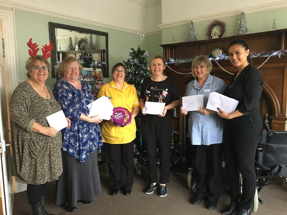 Milford Waterfront brings Christmas cheer to local nursing home residents